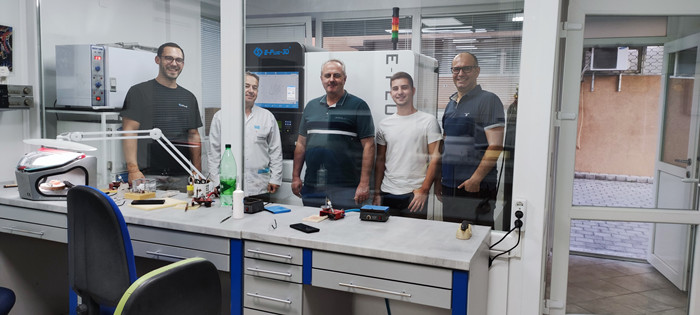 Engineer from Eplus3D with customers from a dental lab